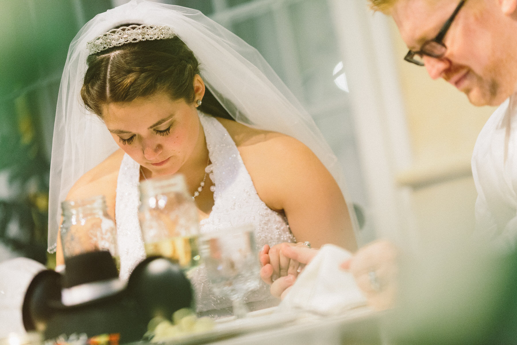 bride and groom praying at doubletree lancaster wedding by Washington DC Wedding Photographer Adam Mason