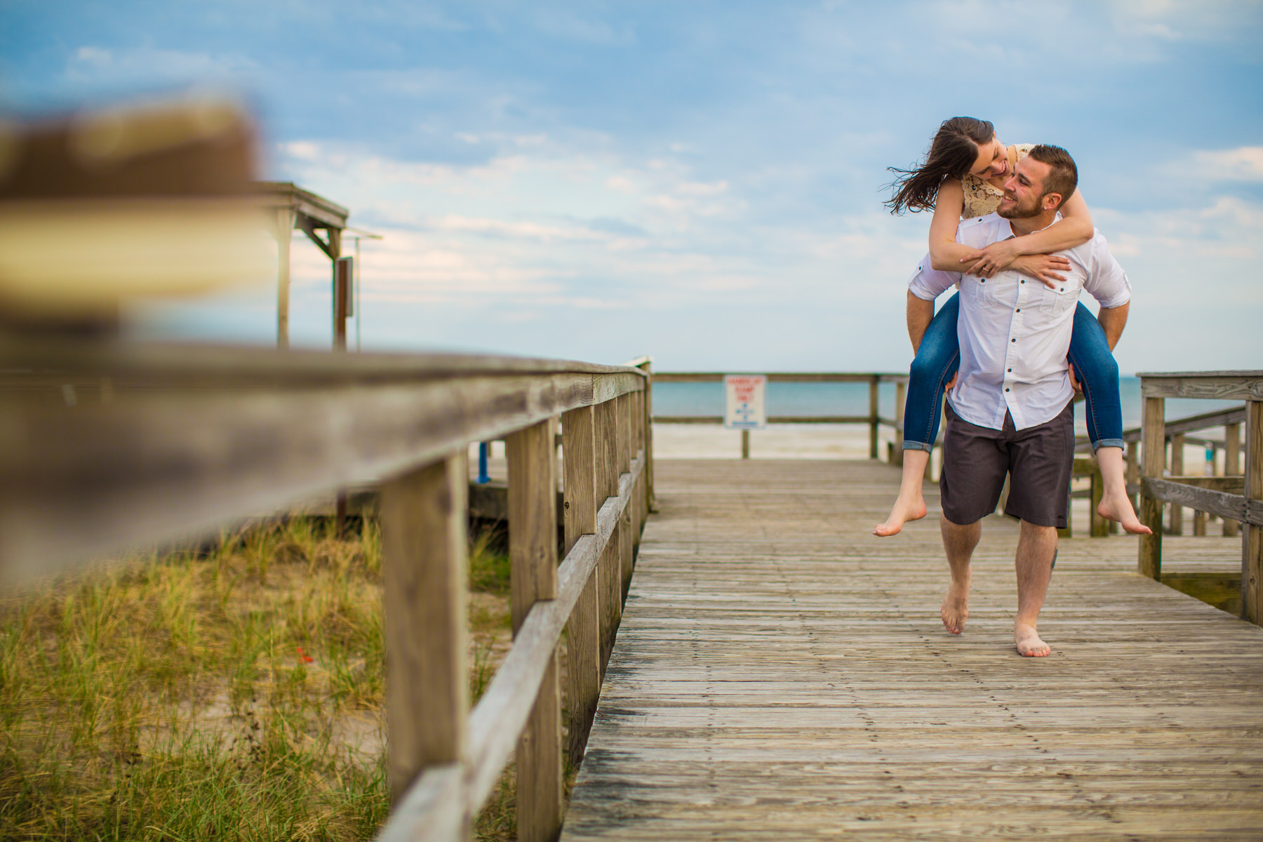 couple on the boardwalk in avalon south jersey