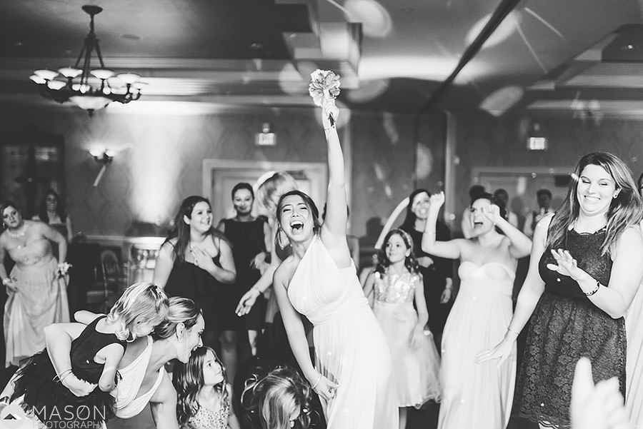 bridesmaid catching the bouquet