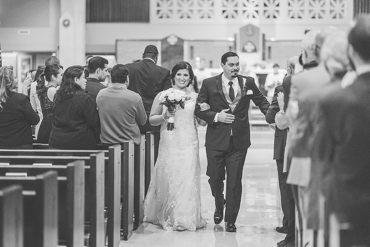 bride and groom walking down the aisle at St Thomas More by Washington DC Wedding Photographer Adam Mason