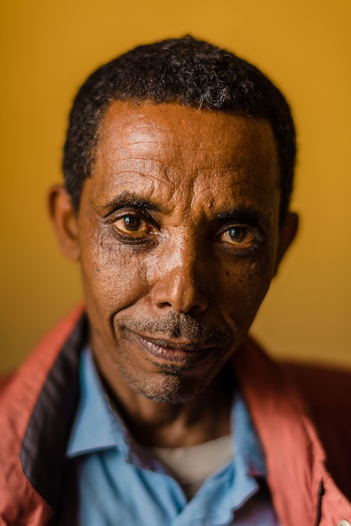 powerful humanitarian photography by Ethiopia and Africa humanitarian photographer in Debre Zeit with Three Roots International by Washington DC Wedding Photographer Adam Mason