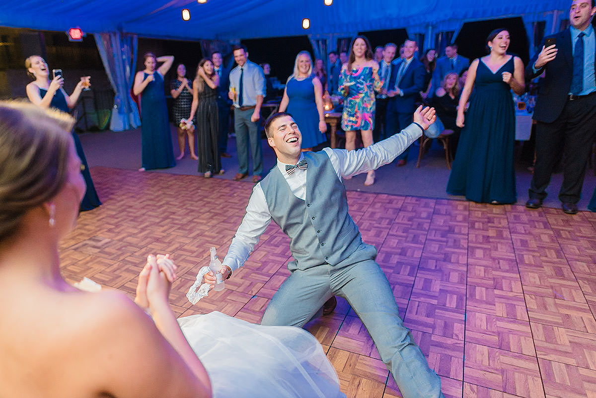 groom breakdancing on the dance floor at wedding guests dancing at reception at philander knox estate wedding by Washington DC Wedding Photographer Adam Mason