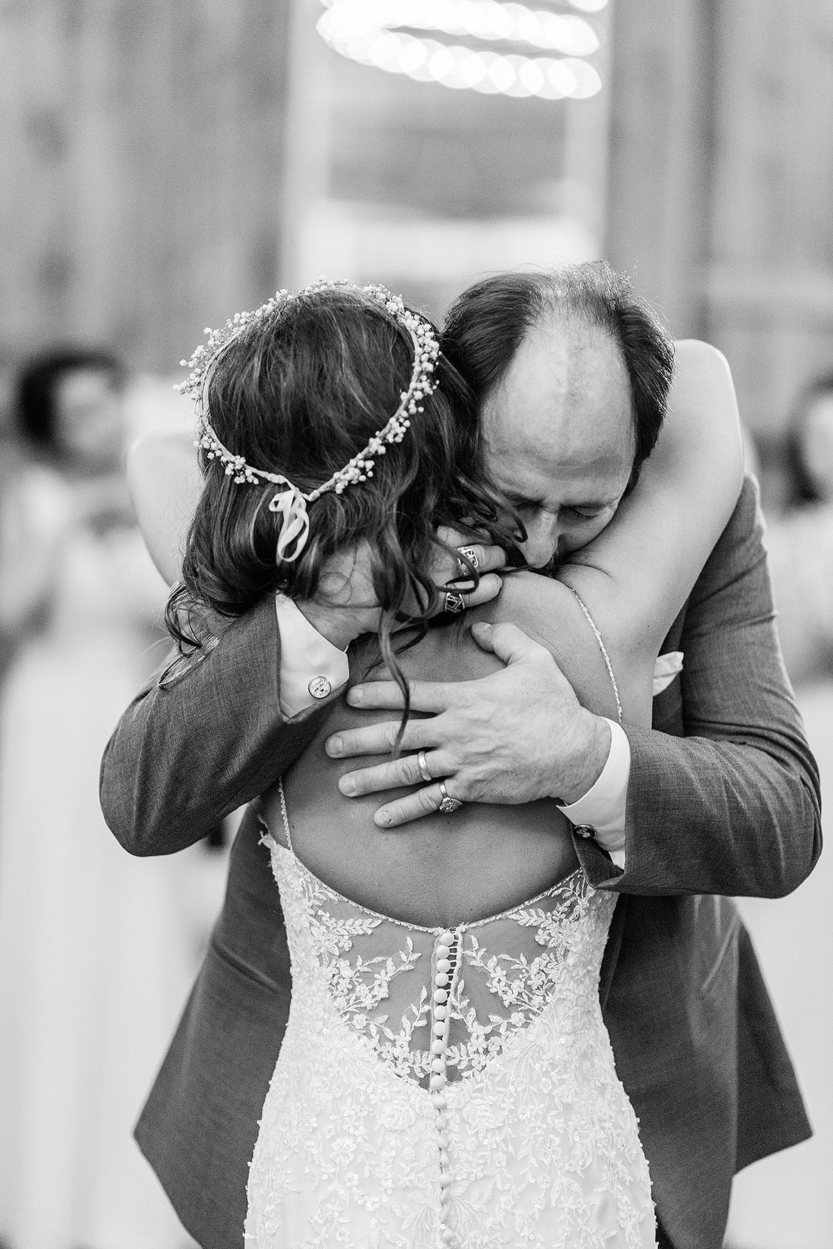 emotional father dad hugging daughter the bride after father daughter dance at wyndridge farm wedding