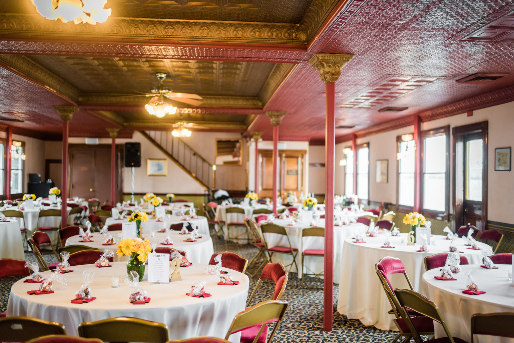 An indoor reception on the Potomac Riverboat Company's Cherry Blossom riverboat by Washington DC Wedding Photographer Adam Mason