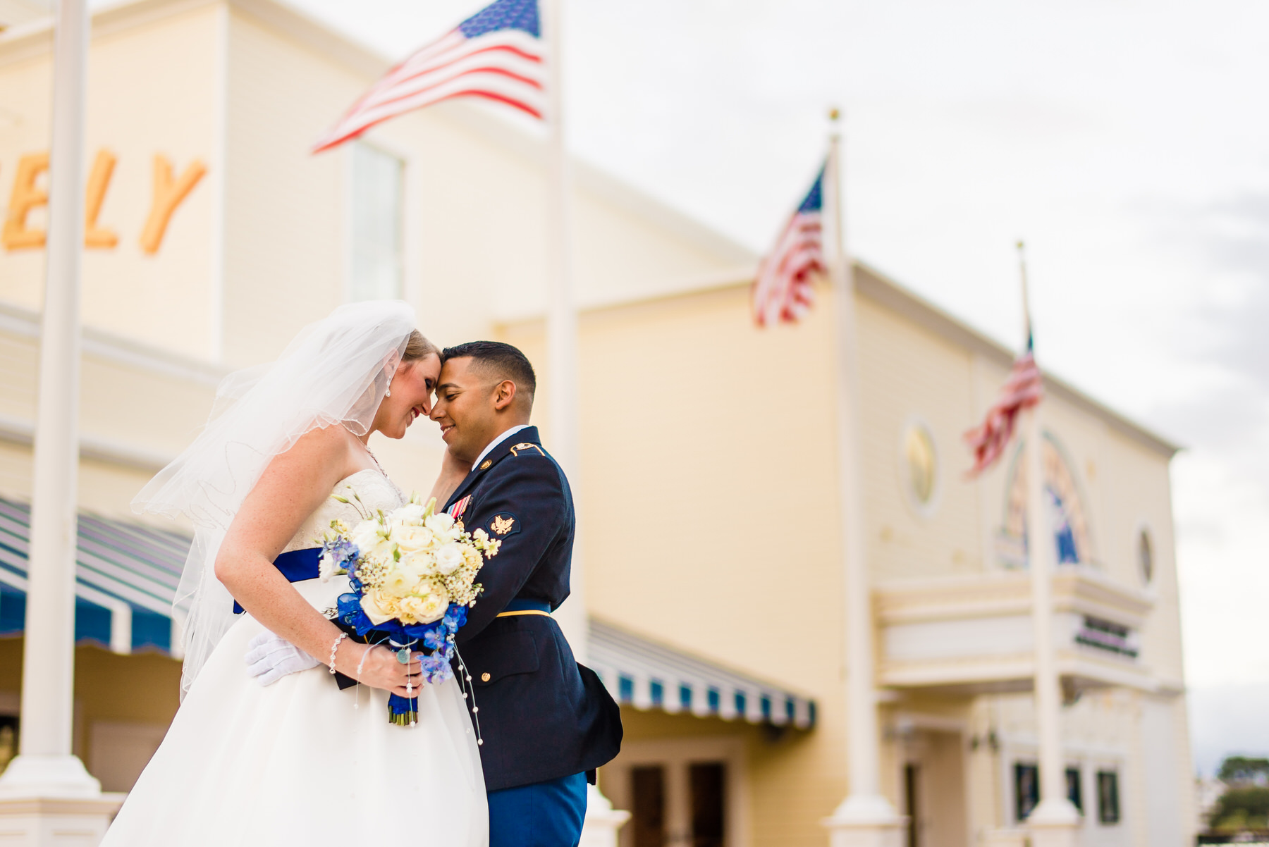 The newlyweds at Disney BoardWalk Inn by Washington DC Wedding Photographer Adam Mason