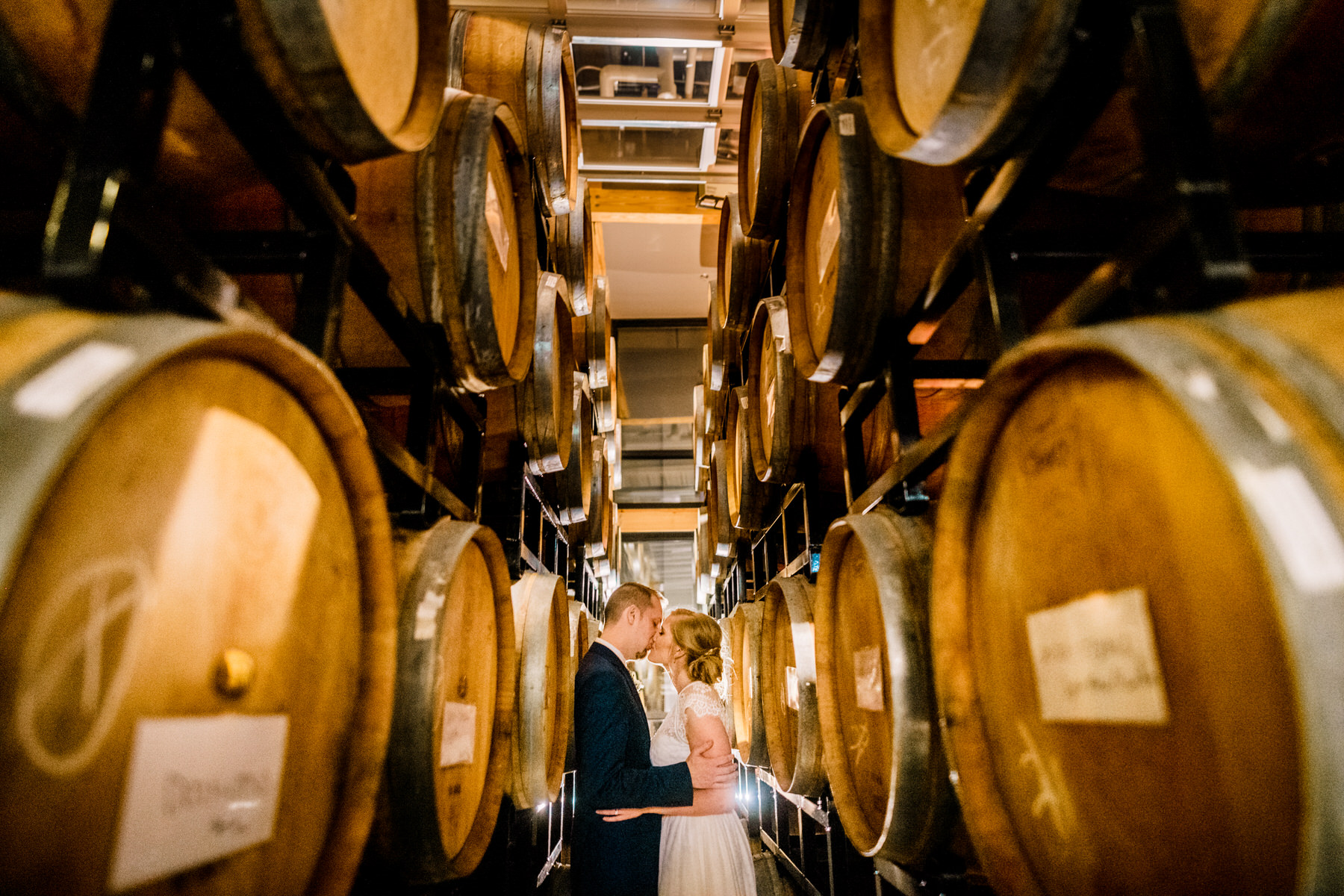 barrel room photo ideas at district winery wedding by Washington DC Wedding Photographer Adam Mason