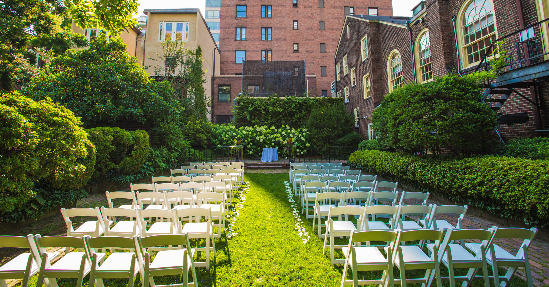 An outdoor ceremony set up at Philadelphia Colonial Dames Society by Washington DC Wedding Photographer Adam Mason