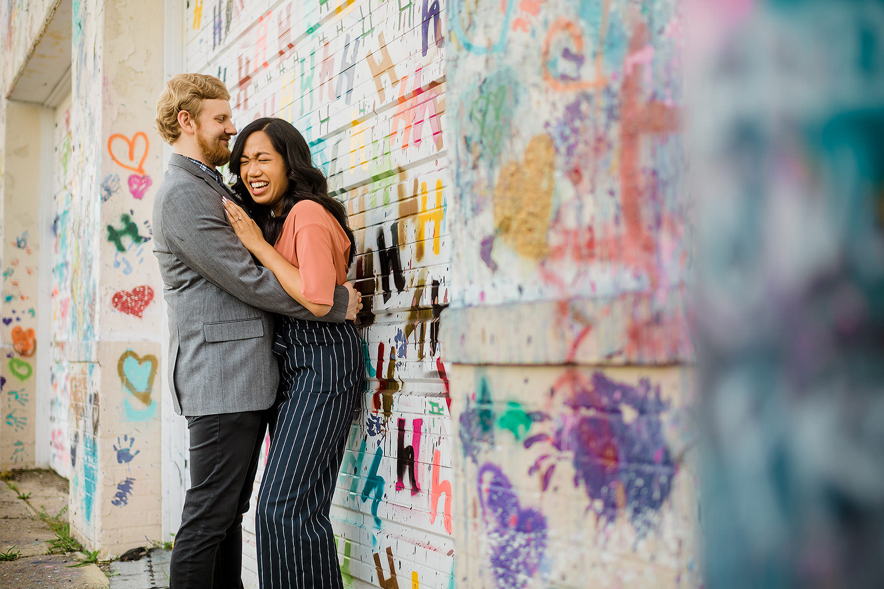 heart wall engagement photos at union market or hyattsville Maryland by Washington DC Wedding Photographer Adam Mason
