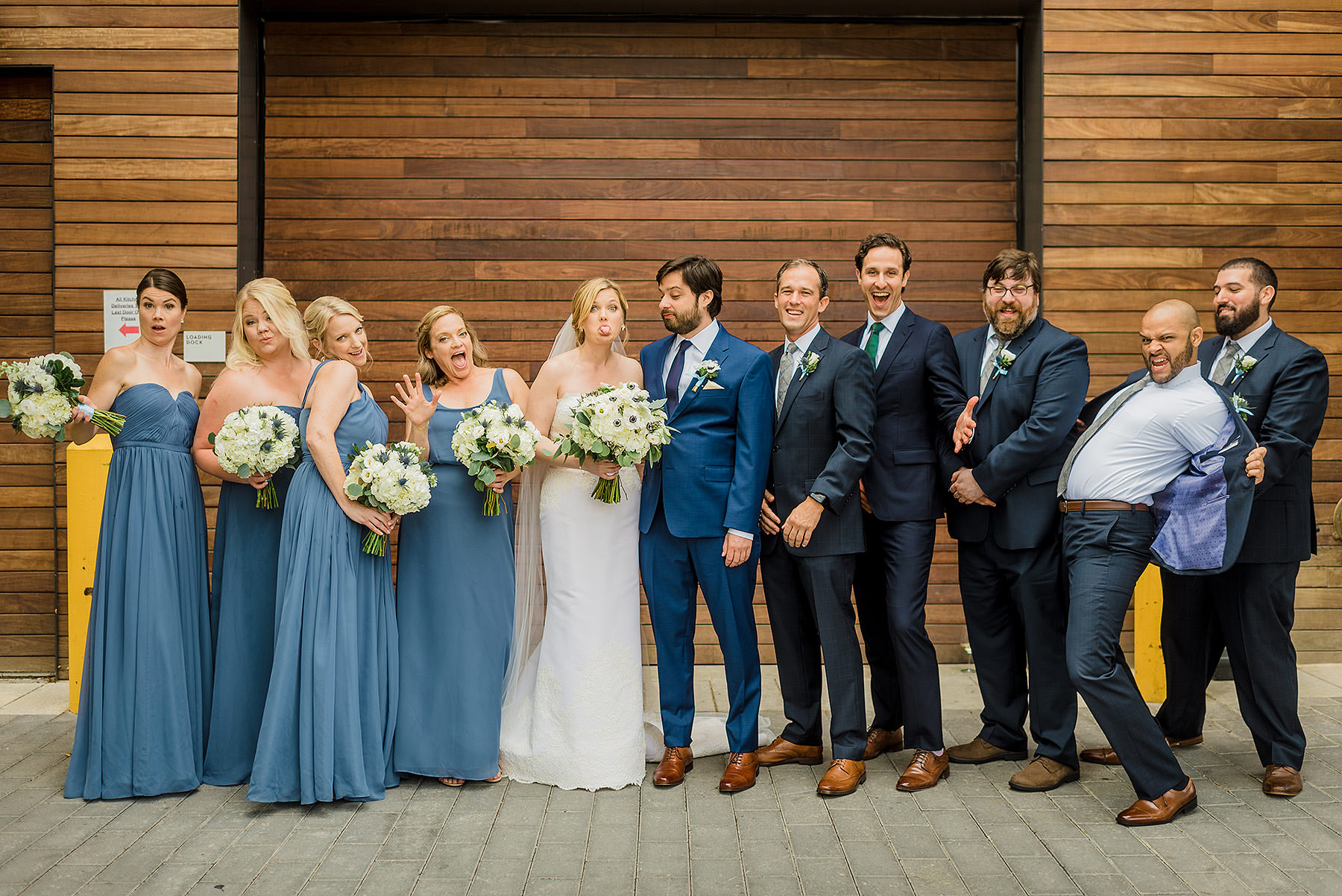 wedding party photos in front of wood wall at summer district winery wedding by Washington DC Wedding Photographer Adam Mason