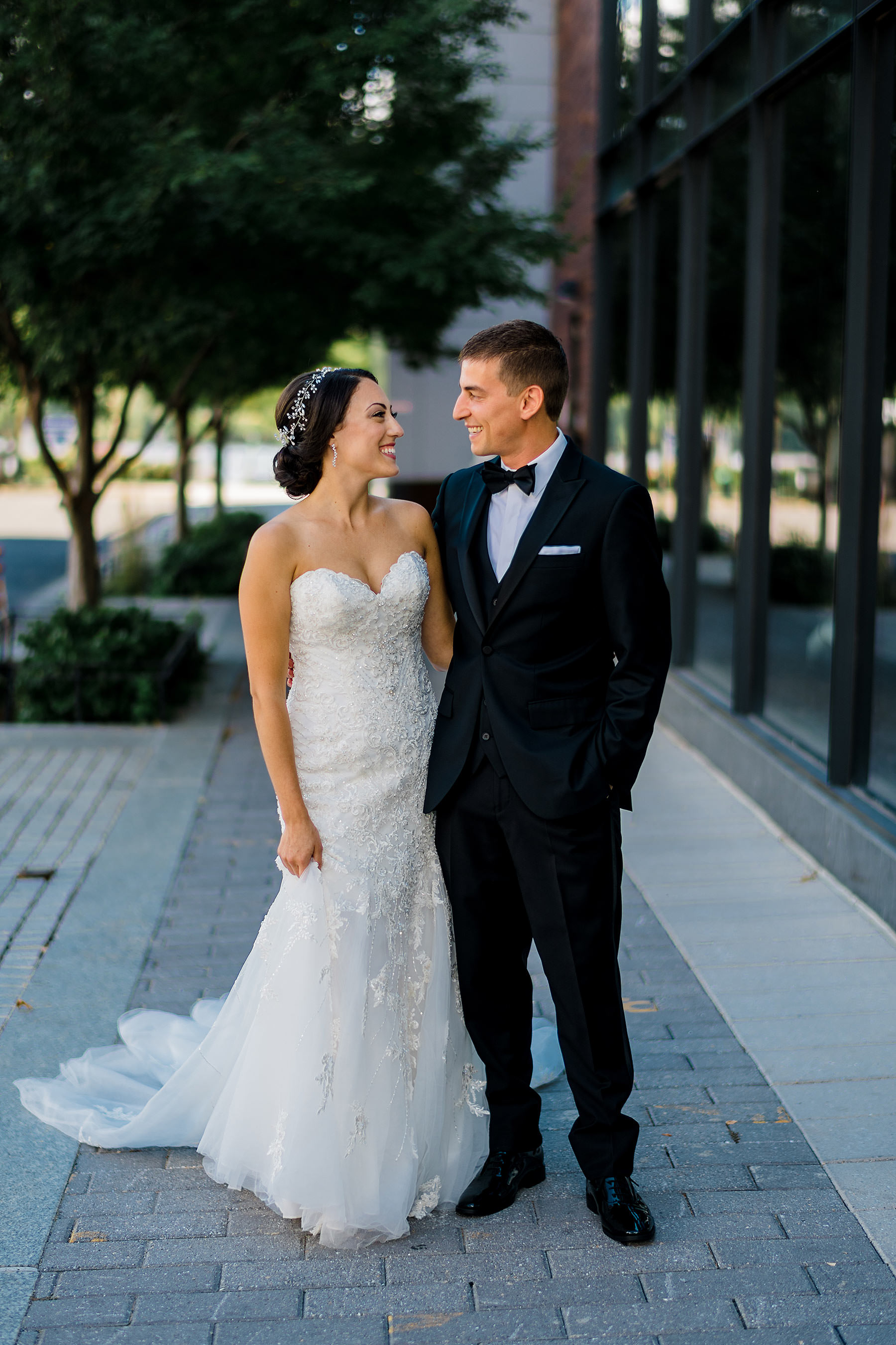 stylish elegant couple at district winery by Washington DC Wedding Photographer Adam Mason
