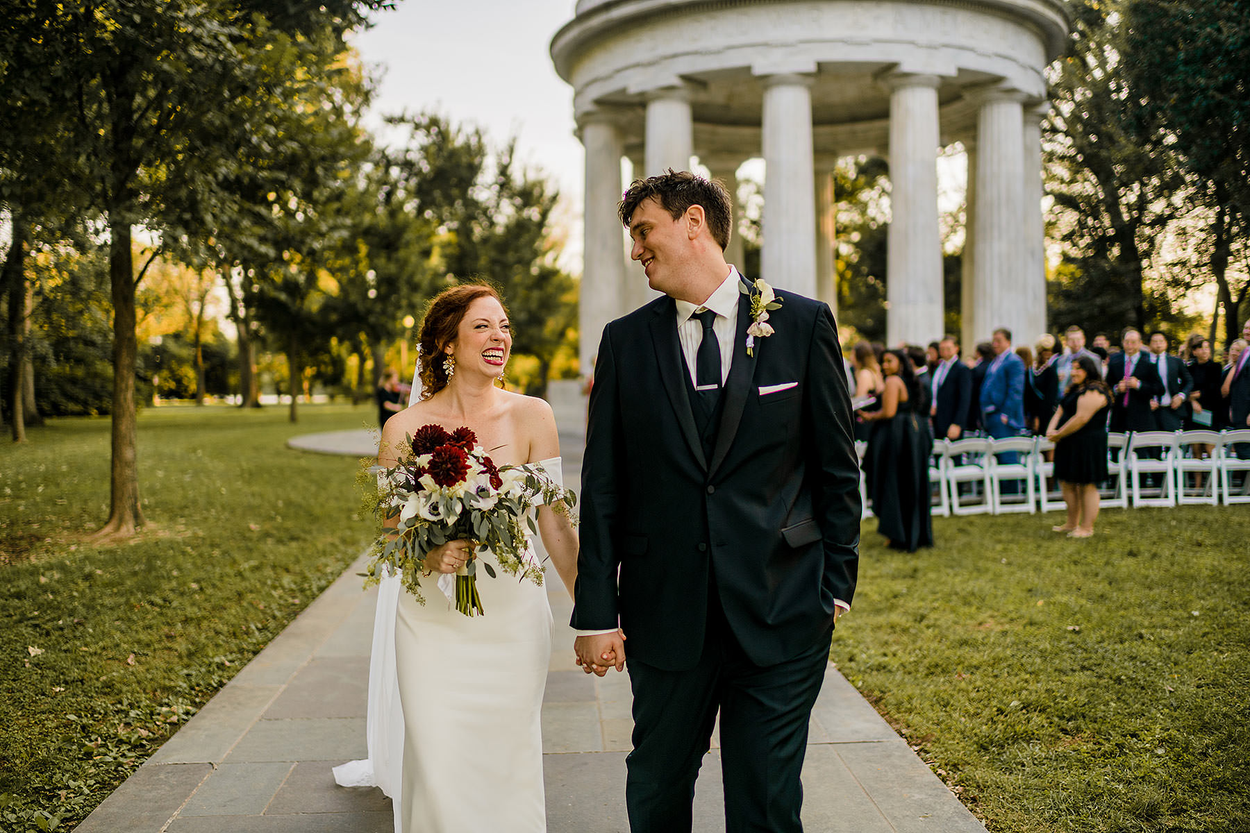 happy and tearful reaction of bride and groom walking down the aisle by Washington DC Wedding Photographer Adam Mason