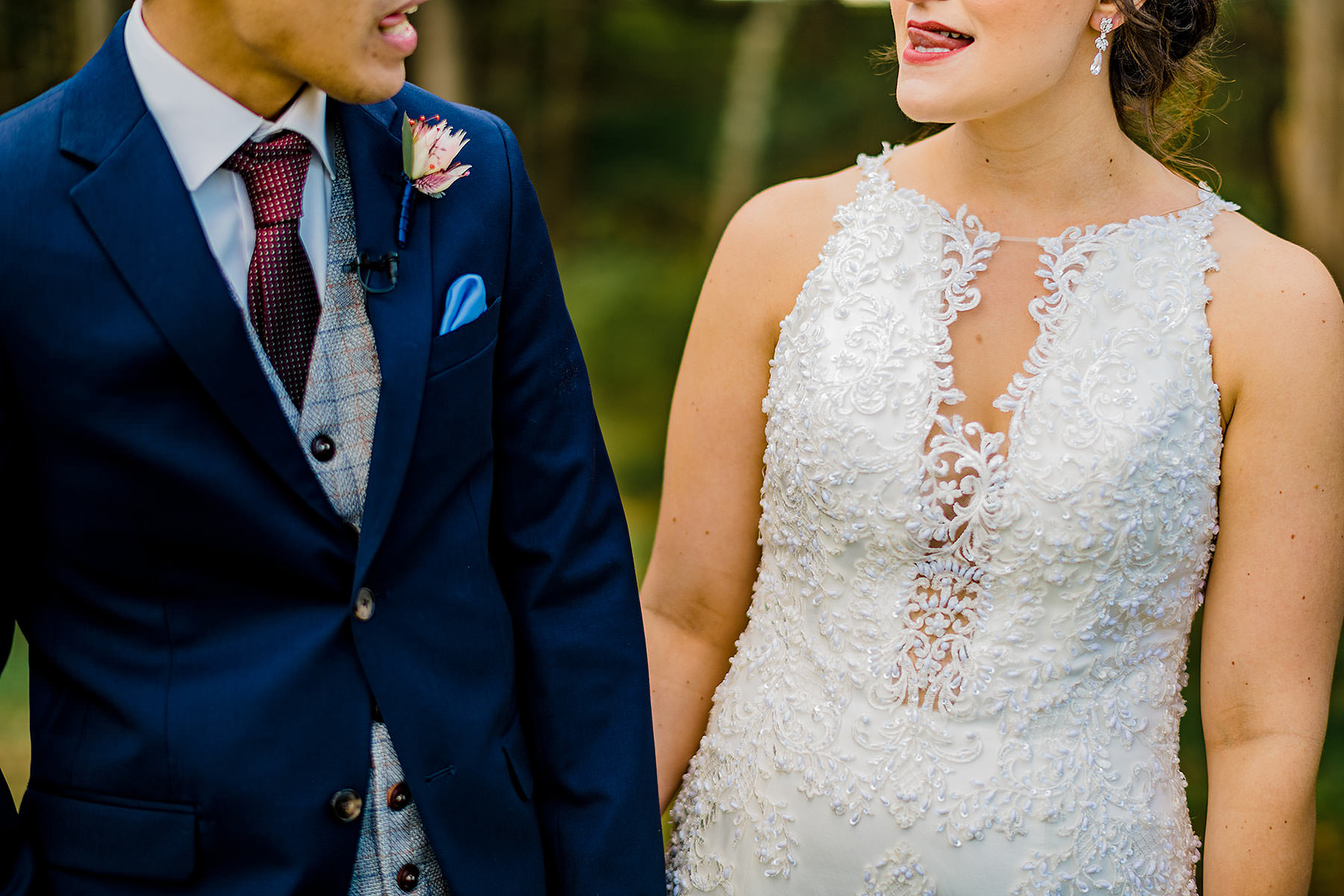 bride and groom lick their lips in funny sexy manner by Washington DC Wedding Photographer Adam Mason