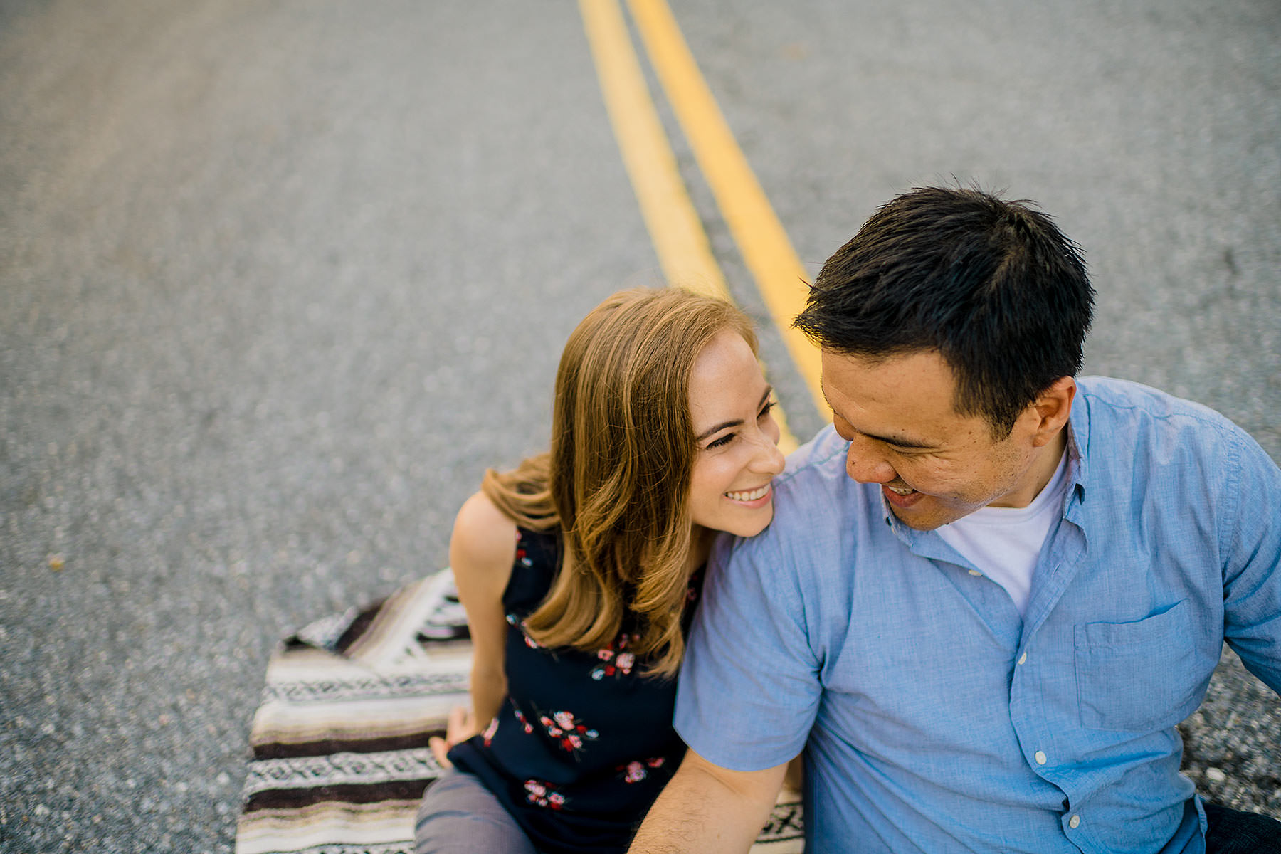 fun engagement photos in dc in the street by Washington DC Wedding Photographer Adam Mason