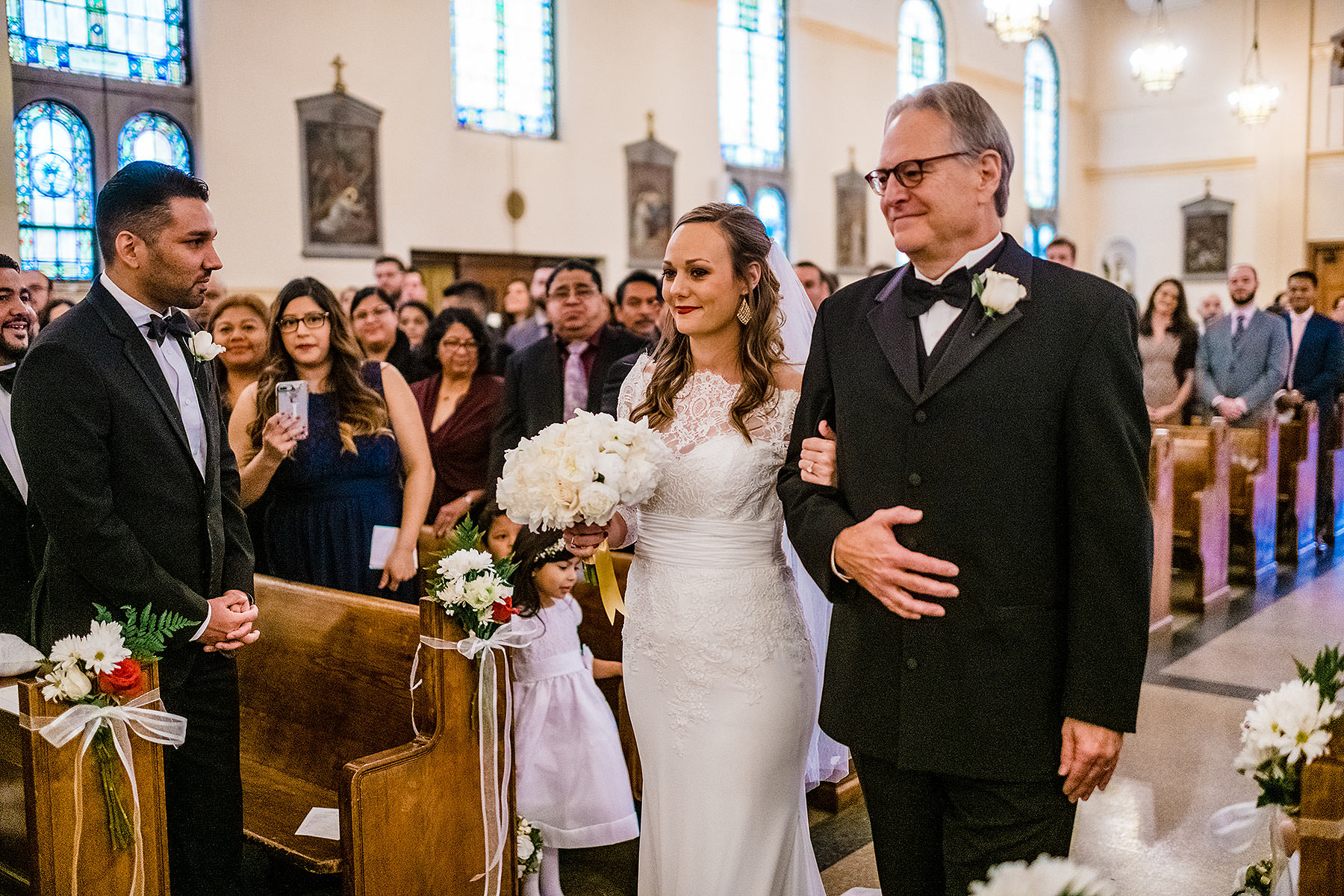 bride being walked down the aisle by her father by Washington DC Wedding Photographer Adam Mason