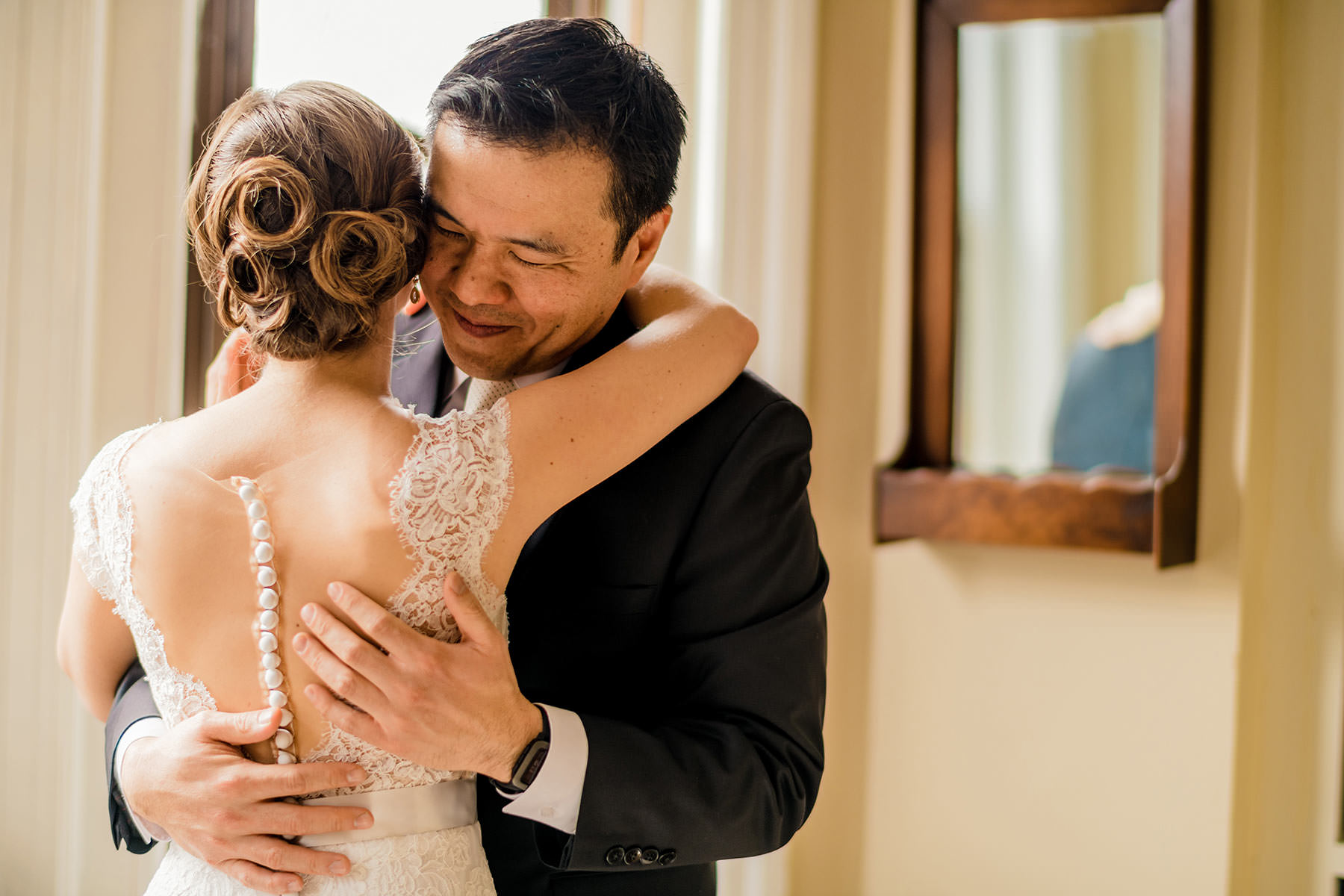 bride and groom embrace in home portraits during cozy dc winter wedding by Washington DC Wedding Photographer Adam Mason
