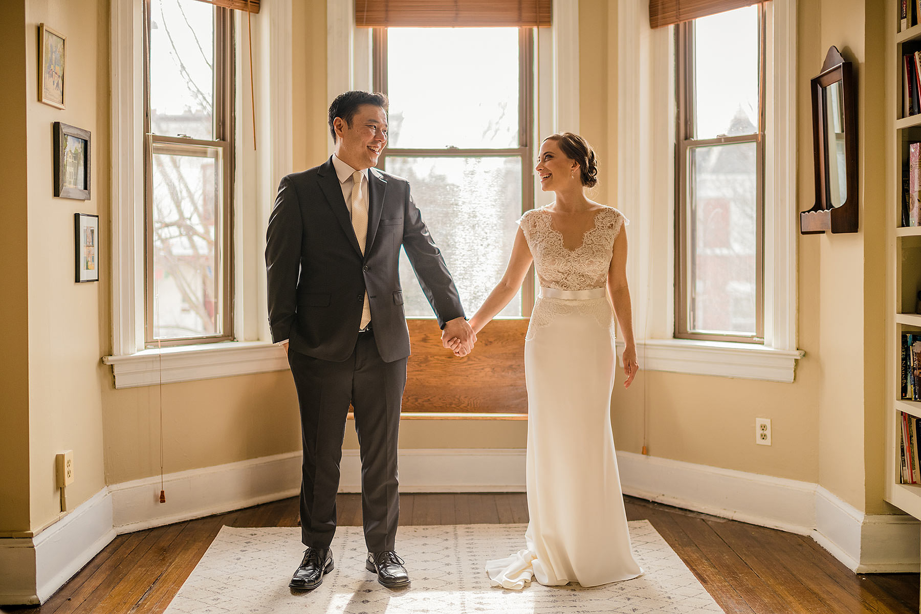 bride and groom take wedding portraits in their new home during cozy dc winter wedding by Washington DC Wedding Photographer Adam Mason