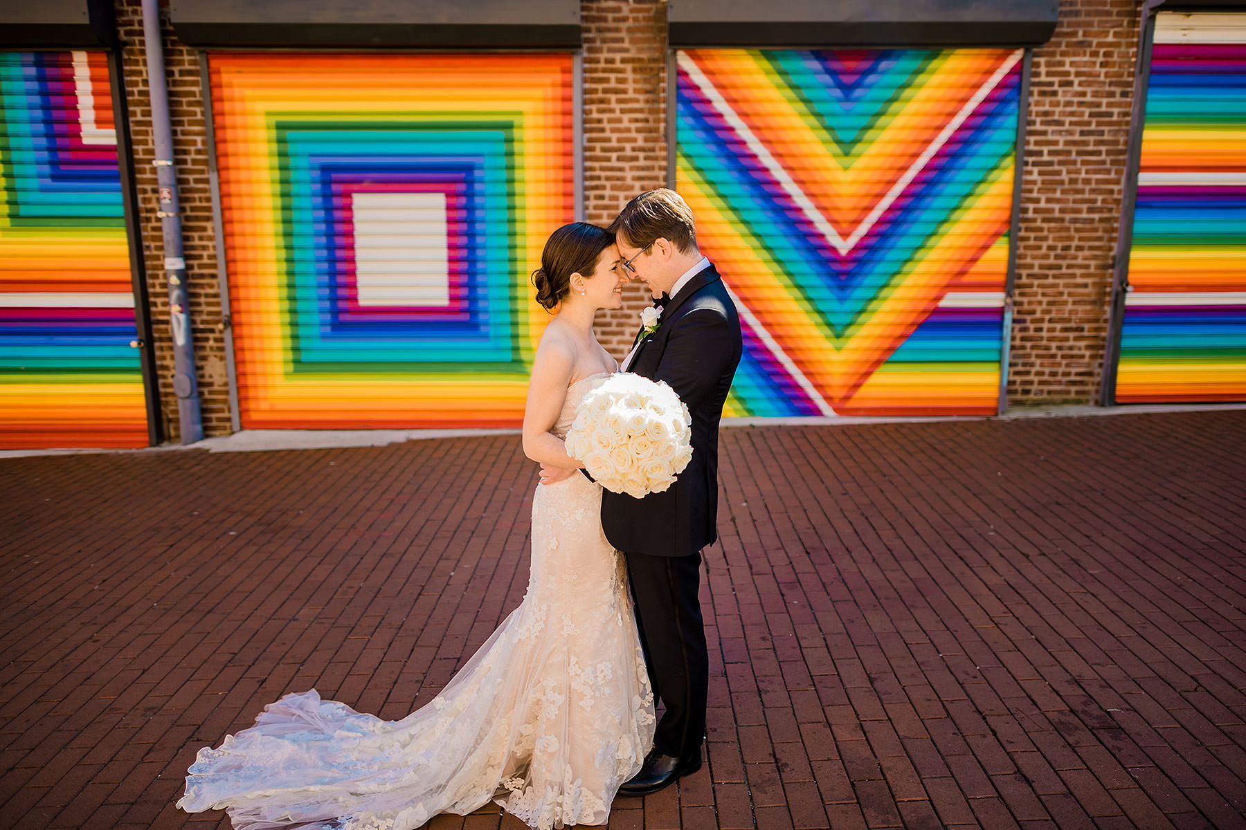 bride and groom wedding photos in blagden alley love mural by Washington DC Wedding Photographer Adam Mason