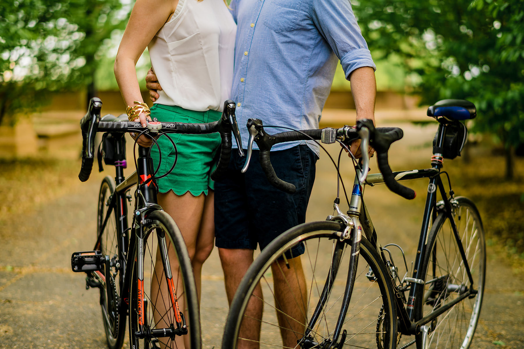 couple portraits with their bikes at meridian hill park during downtown dc engagement session by Washington DC Wedding Photographer Adam Mason