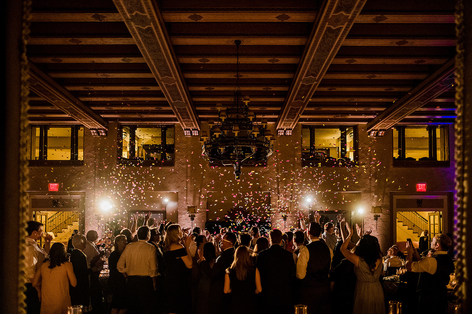 confetti falls from the ceiling during reception at congressional country club wedding by Washington DC Wedding Photographer Adam Mason