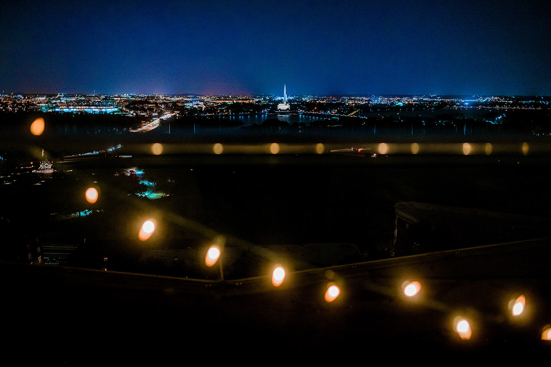 creative dc photo at top of the town rooftop by Washington DC Wedding Photographer Adam Mason