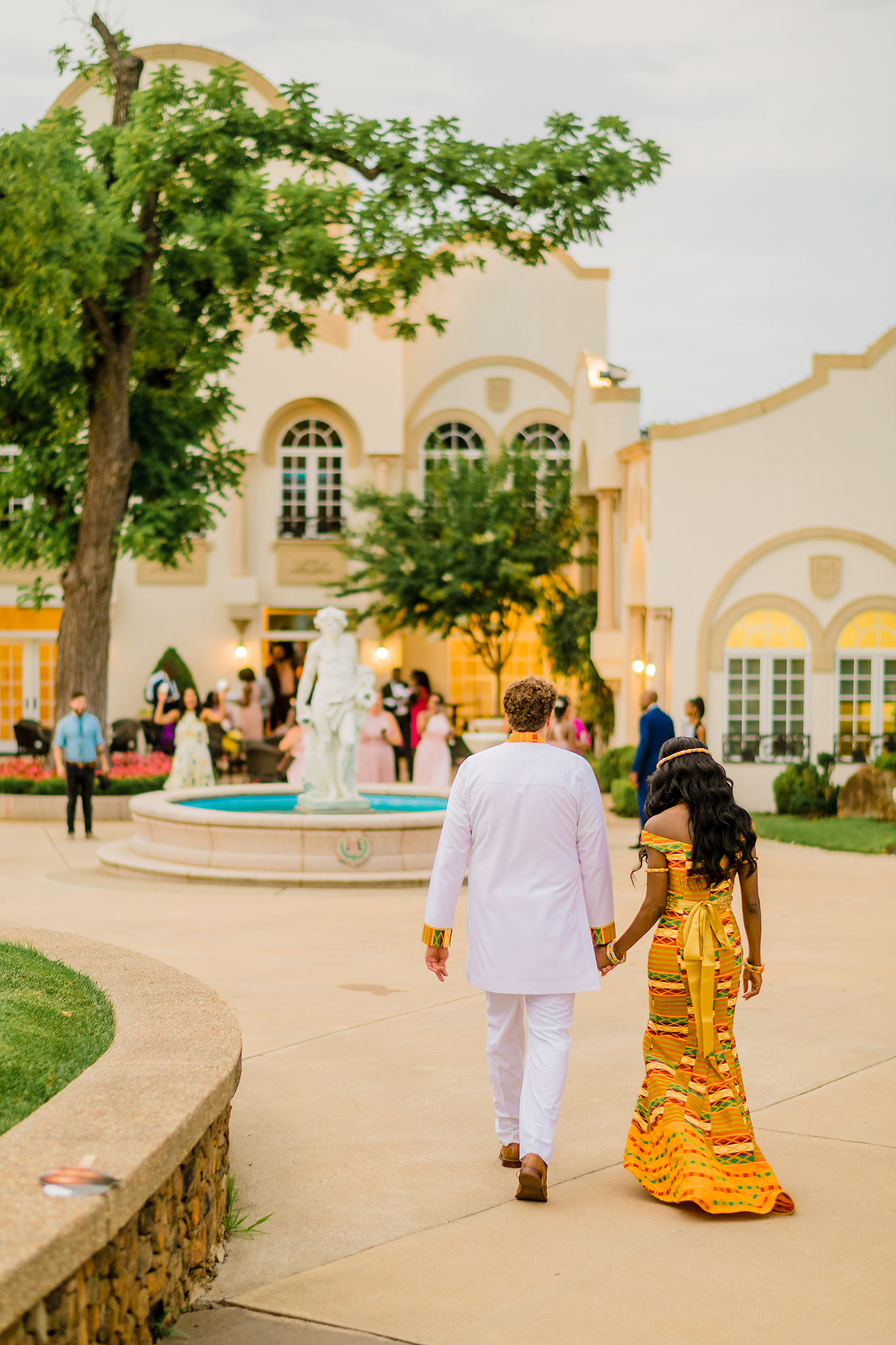 bride and groom in traditional ghanian wardrobes during wedding at morais vineyards and winery by Washington DC Wedding Photographer Adam Mason