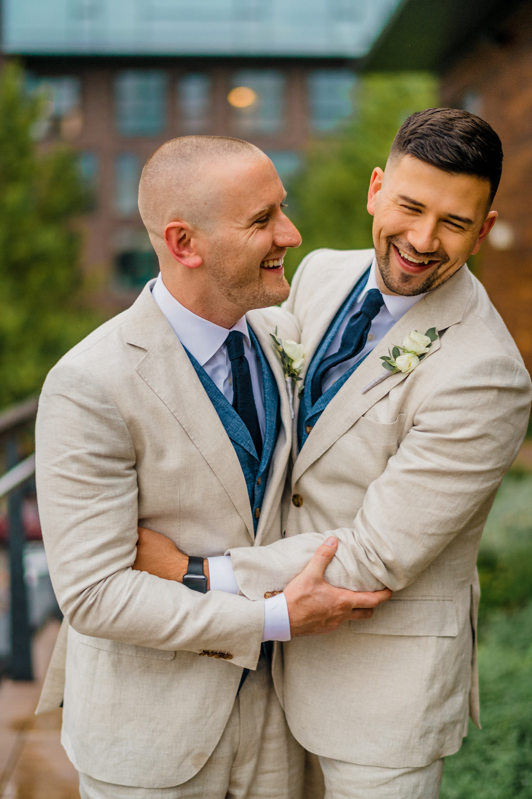 blushing grooms in suit supply suits on wedding day by Washington DC Wedding Photographer Adam Mason