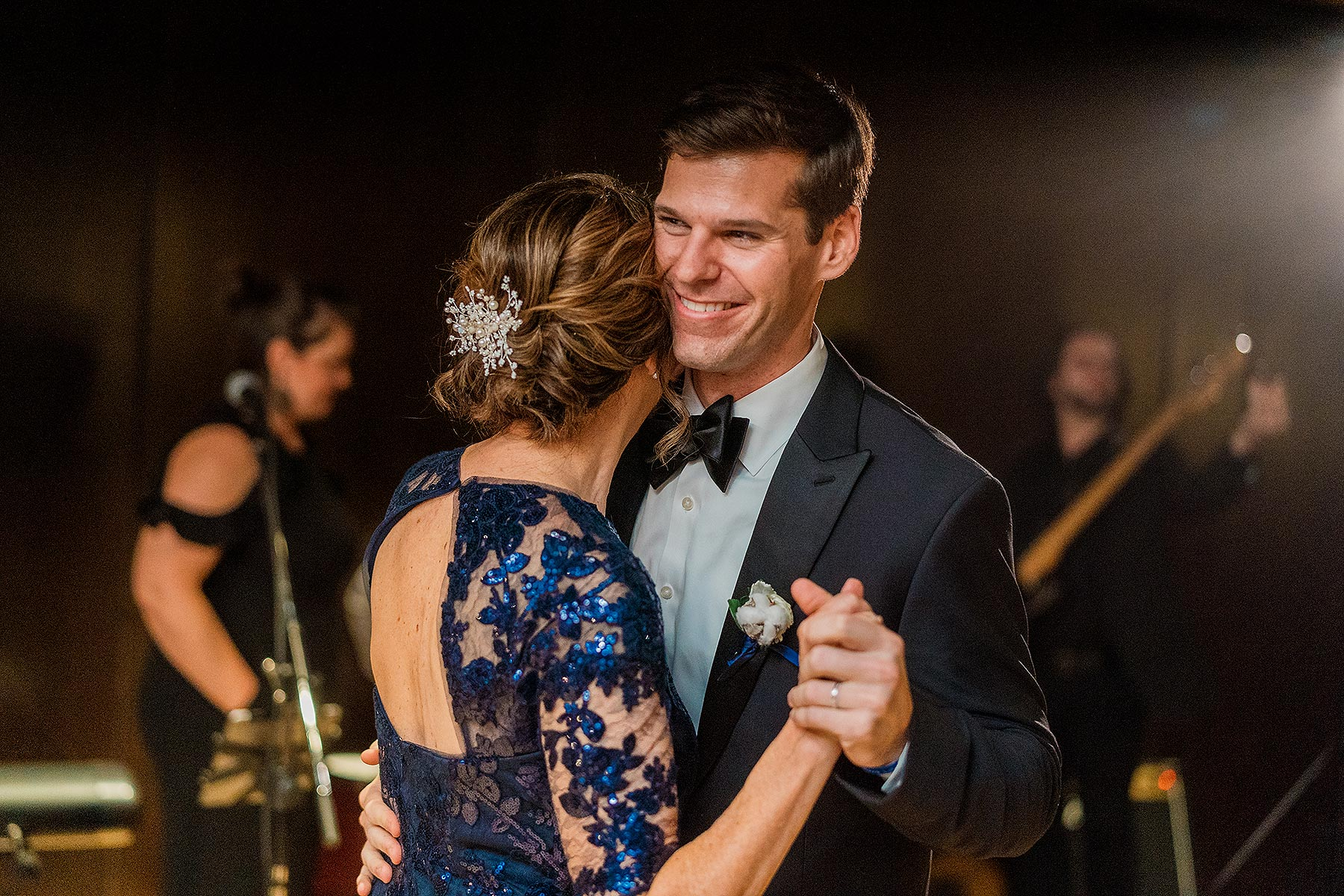 groom smiling as he dances with mom at district winery wedding reception by Washington DC Wedding Photographer Adam Mason