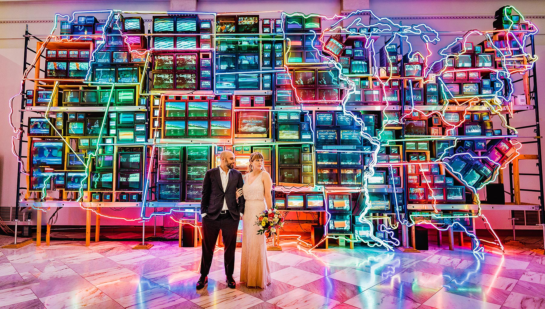 dc couple elopes in front of information superhighway at national portrait gallery wedding by Washington DC Wedding Photographer Adam Mason