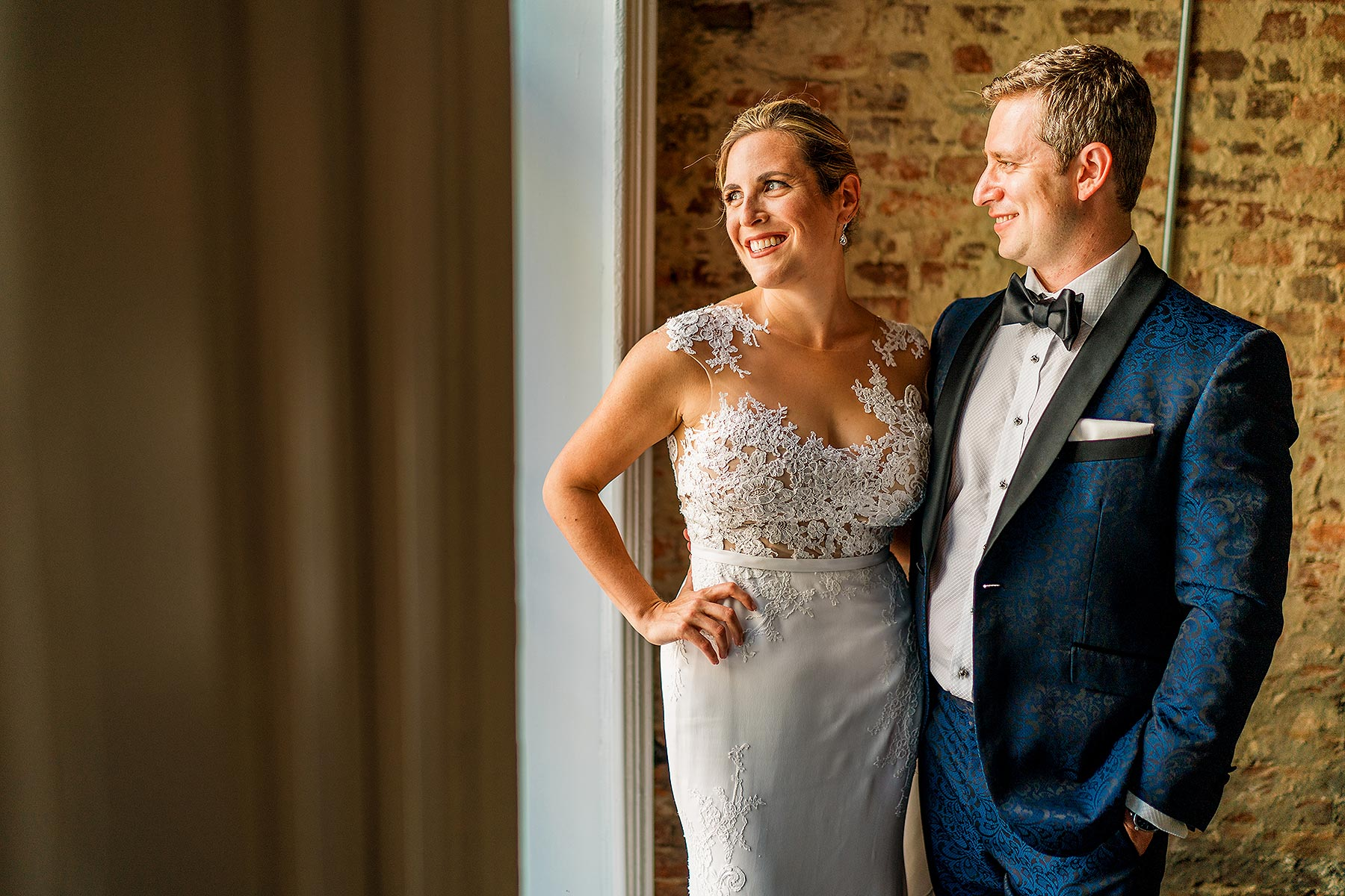 bride and groom wedding portraits in industrial brick building by Washington DC Wedding Photographer Adam Mason