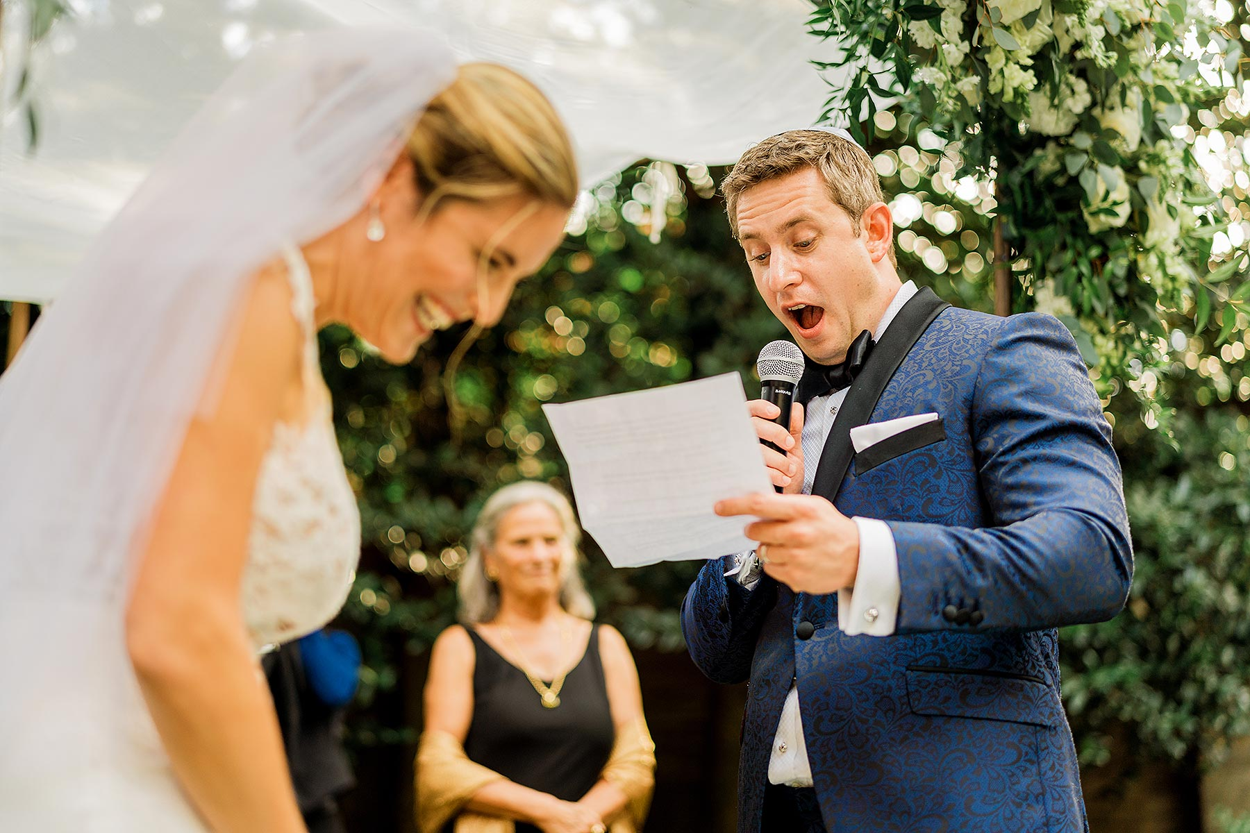 bride laughing during grooms vows at larz anderson house wedding by Washington DC Wedding Photographer Adam Mason