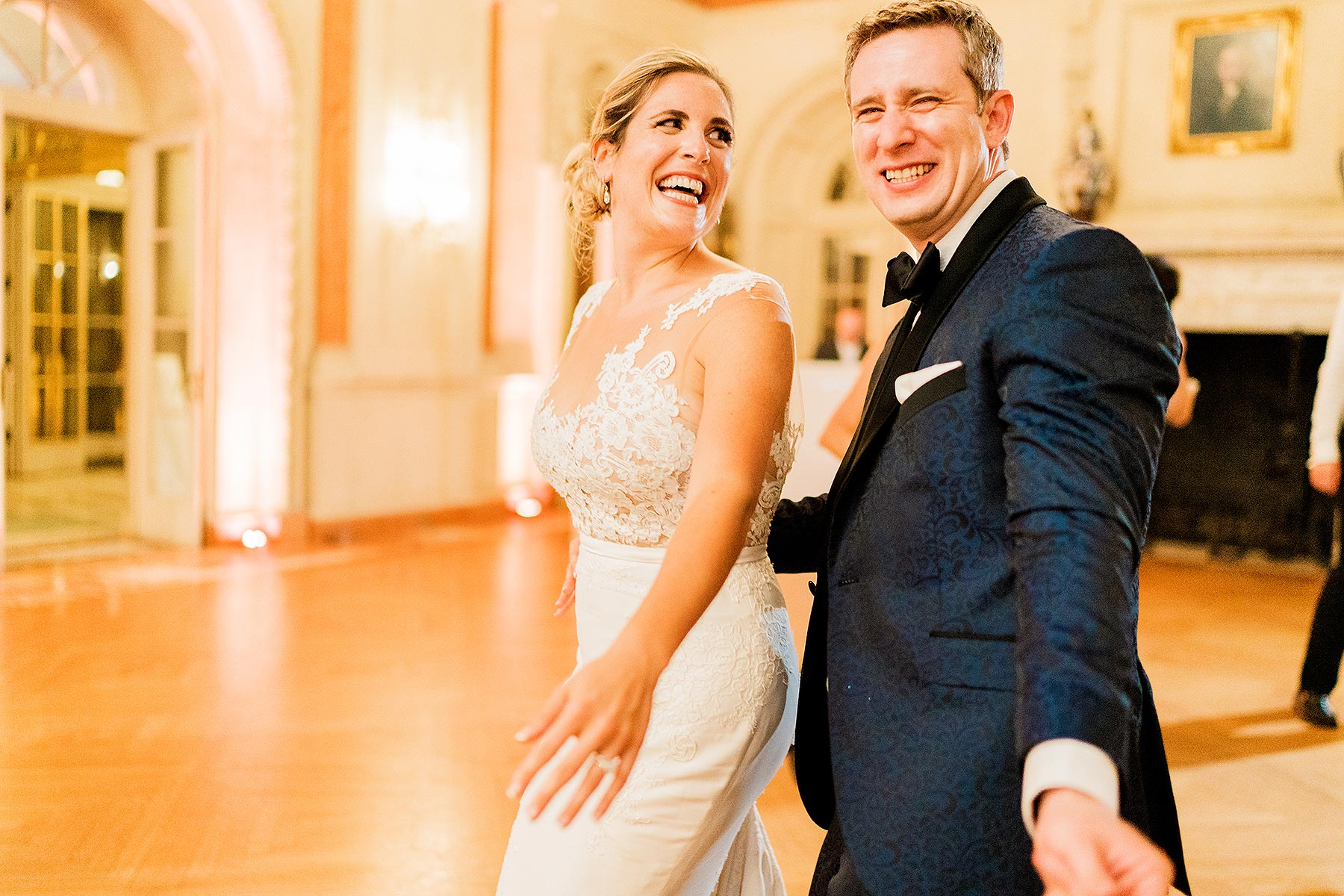 bride and groom enjoying themselves on the dance floor at larz anderson house wedding by Washington DC Wedding Photographer Adam Mason