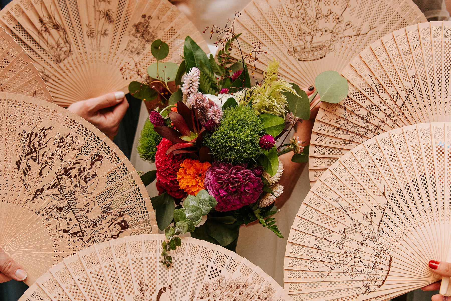 flowers and asian fans as wedding decorations for bridesmaids